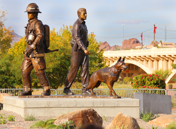 bronze statue of a fire fighter, police officer, and police canine