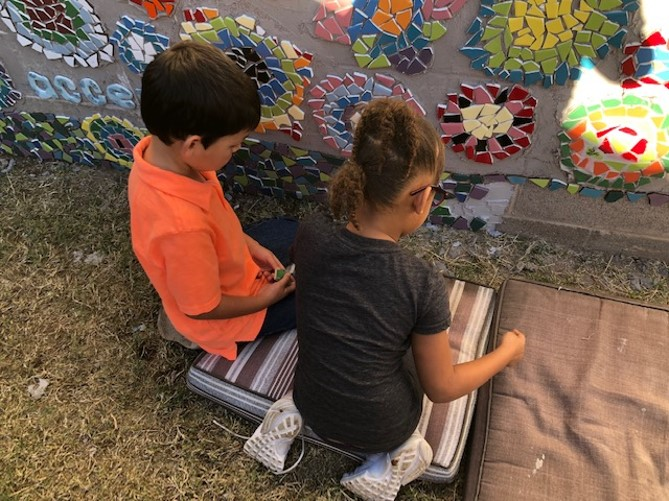 more kids putting mosaic on wall