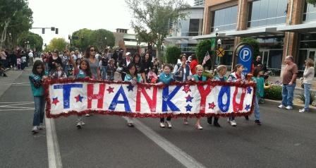Girl Scouts marching in Veterans Day Parade