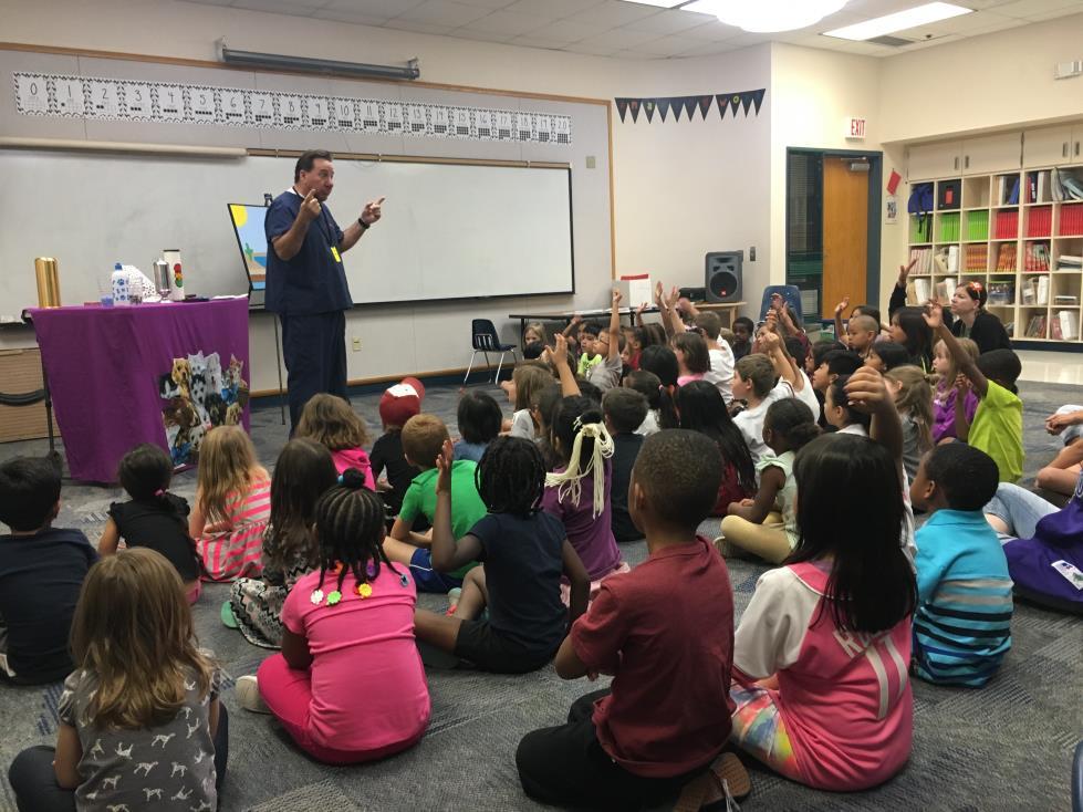 Presenter in front of children.